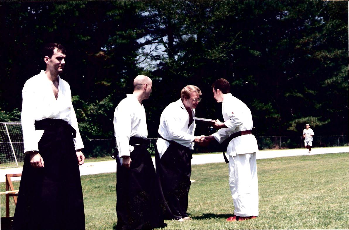 Sensei awarding Rich new belt 1997